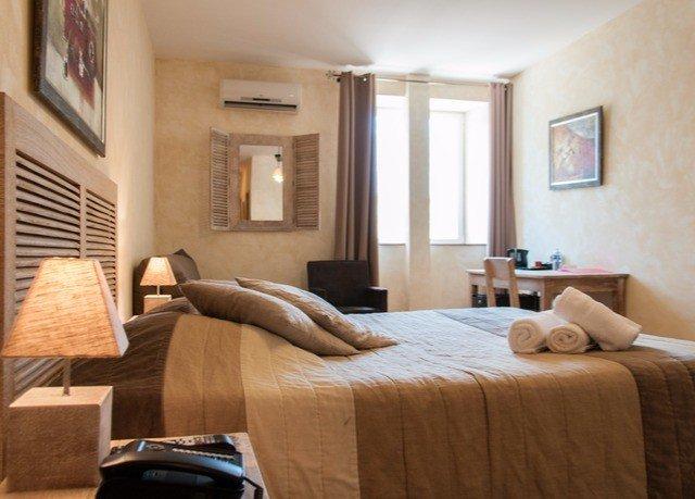 sofa property Bedroom living room home hardwood Suite cottage condominium tan