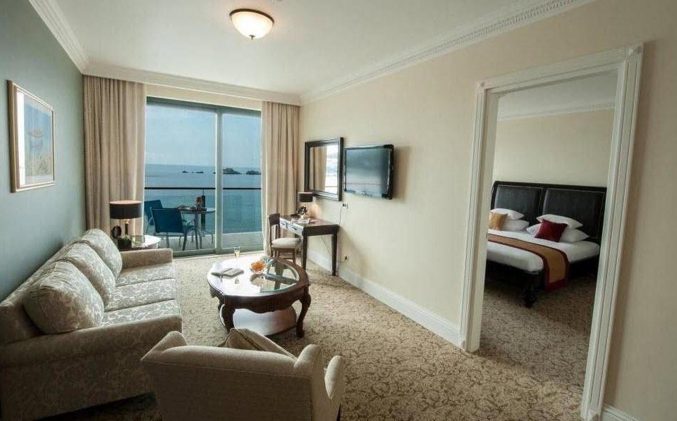 sofa property Suite home cottage living room condominium Bedroom tan