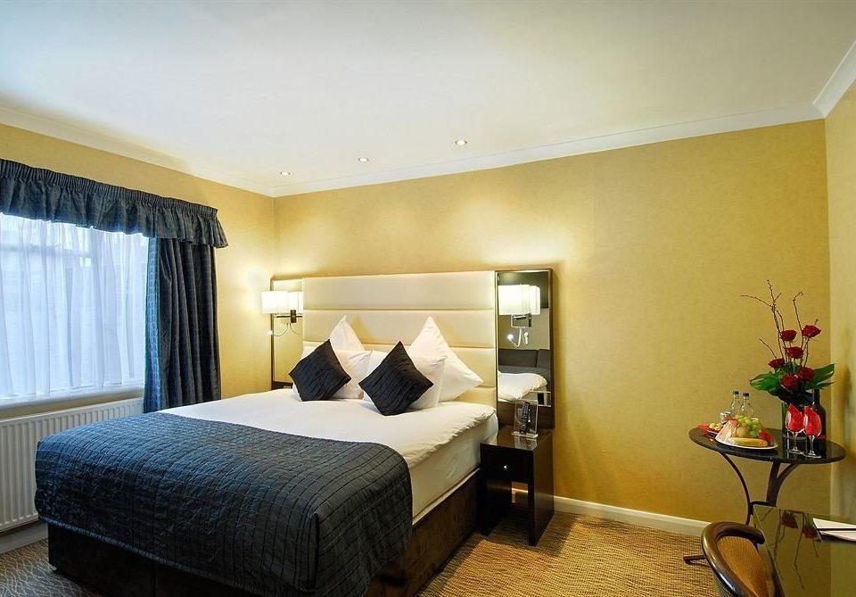 property Bedroom Suite condominium yellow cottage lamp