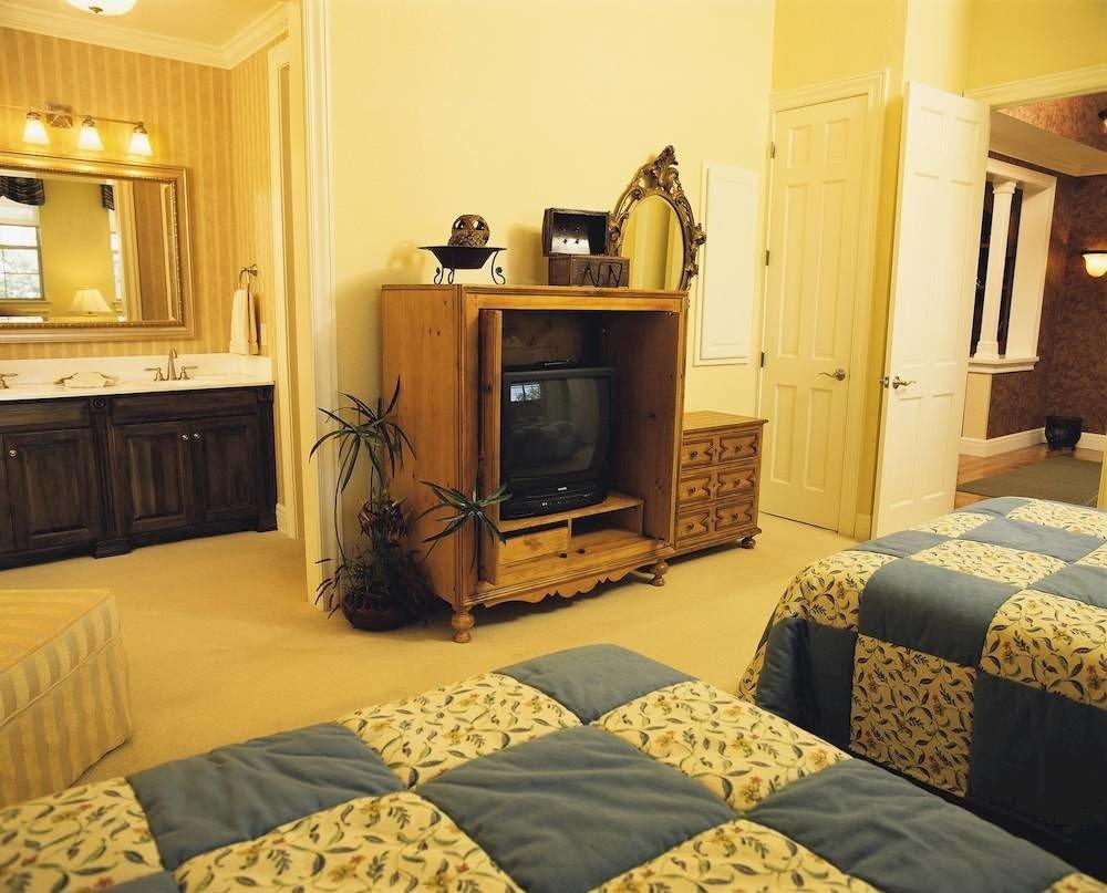 property home yellow Suite house living room cottage Bedroom condominium flooring