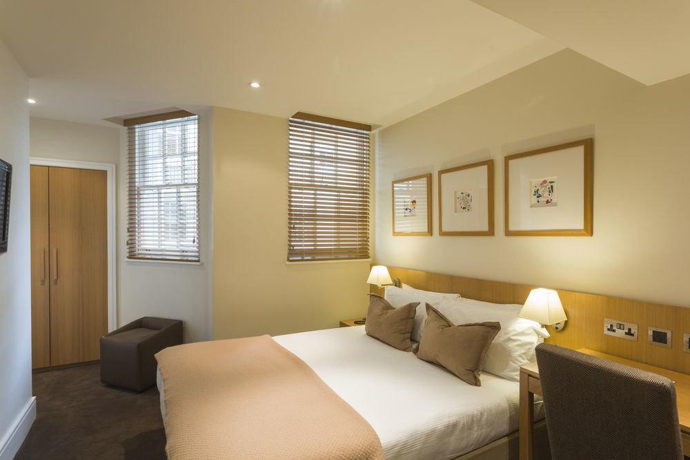 property Bedroom Suite cottage home yellow condominium living room tan