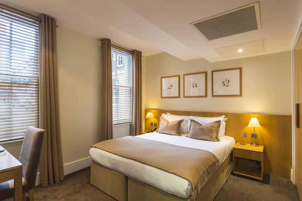 property Bedroom Suite home cottage condominium living room tan