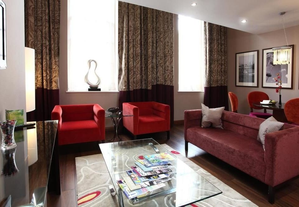 sofa property red living room Suite condominium home cottage flat Bedroom