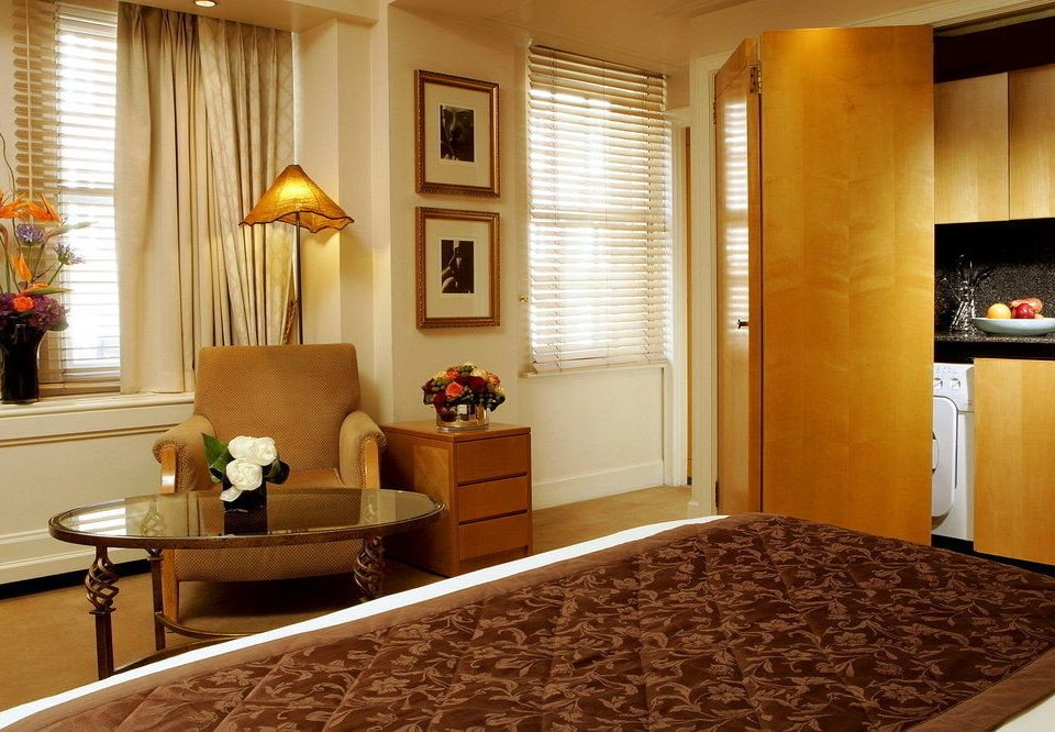 property Suite home Bedroom living room hardwood cottage condominium window treatment curtain
