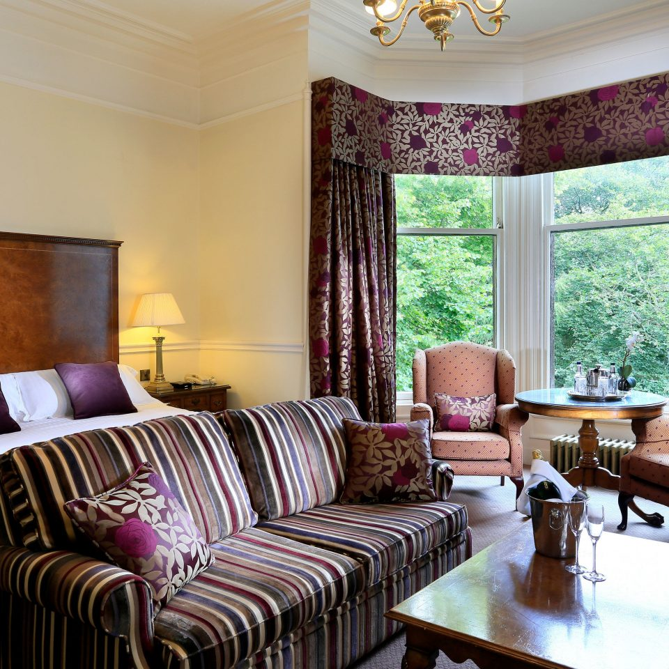 sofa property living room Suite home condominium Bedroom cottage seat