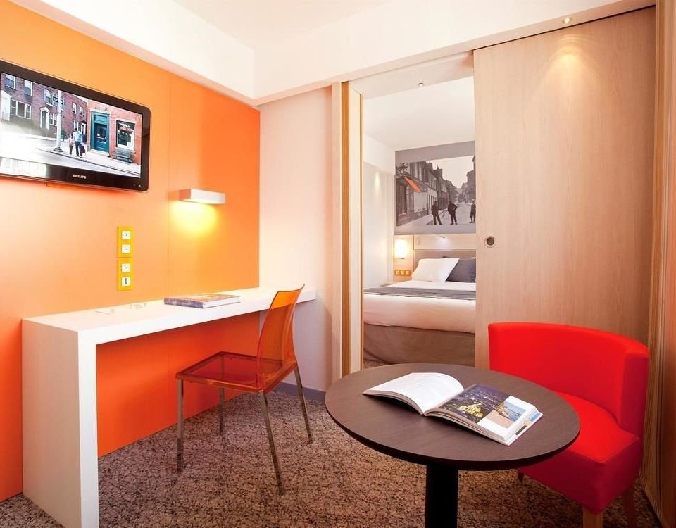property Suite red condominium home cottage living room orange Bedroom