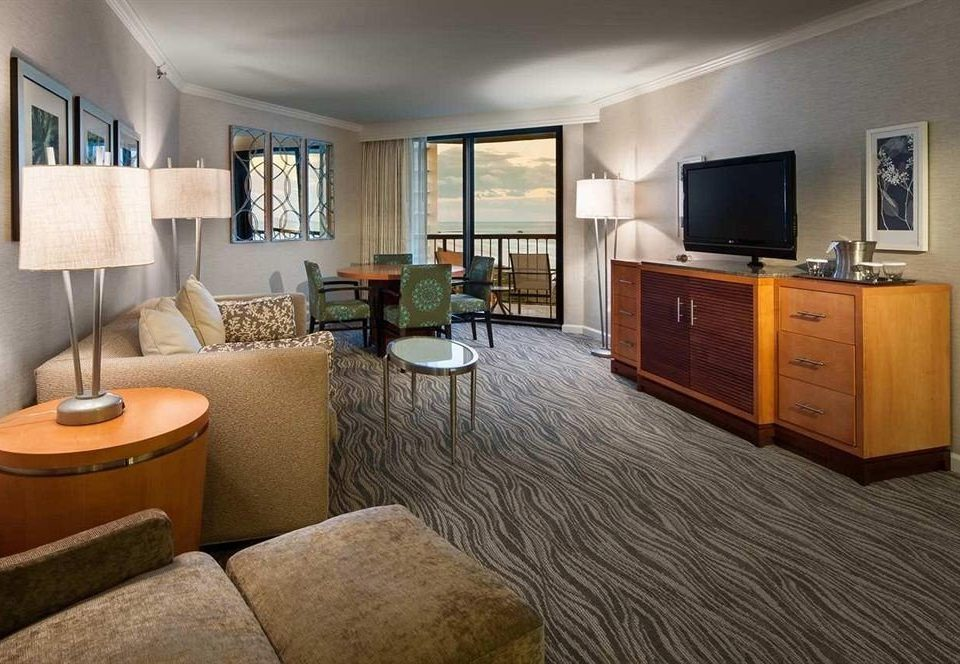 sofa property Bedroom living room home condominium hardwood Suite cottage wood flooring flat