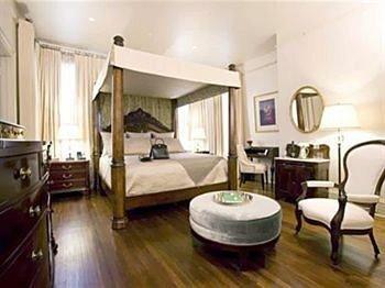 property condominium Suite cottage hardwood hard wood flooring Bedroom