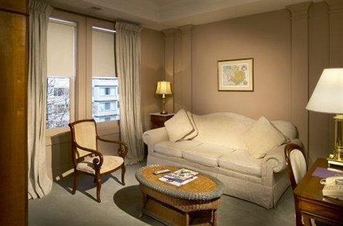 sofa property Suite living room cottage Bedroom home condominium lamp tan