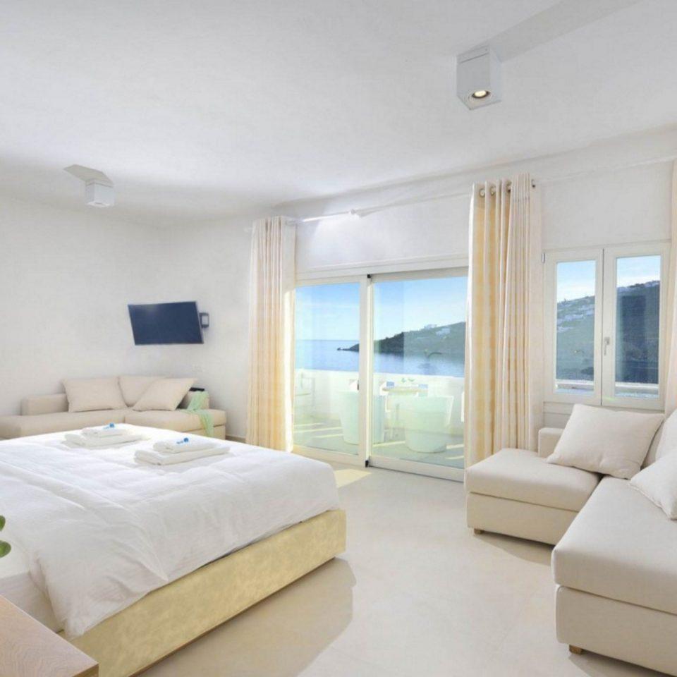sofa property Bedroom scene Suite white cottage condominium living room