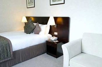 sofa property Suite cottage pillow condominium seat Bedroom tan