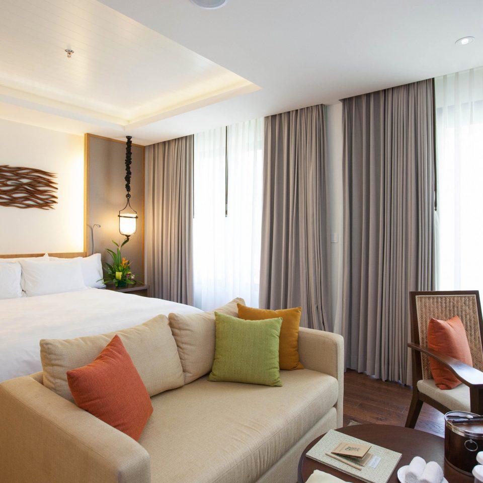 sofa property Suite condominium living room home flat cottage Bedroom