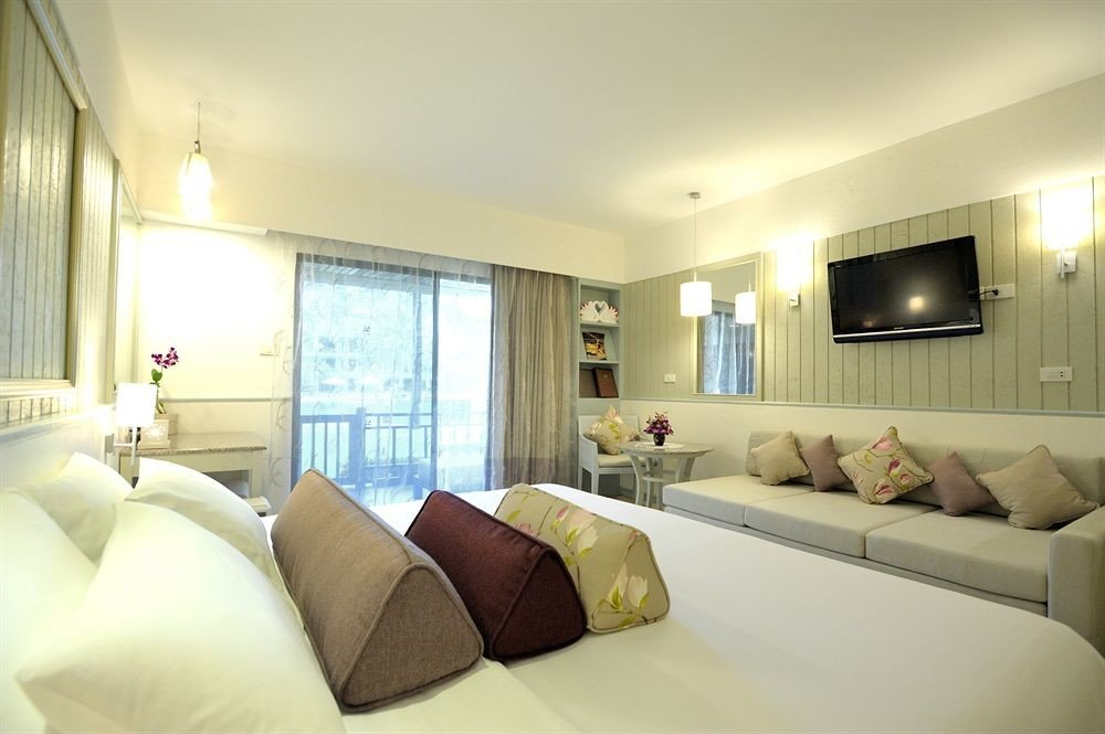 sofa property pillow Suite condominium living room home Bedroom cottage