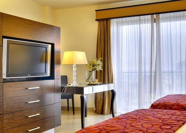 property Bedroom Suite hardwood living room home condominium curtain window treatment flat