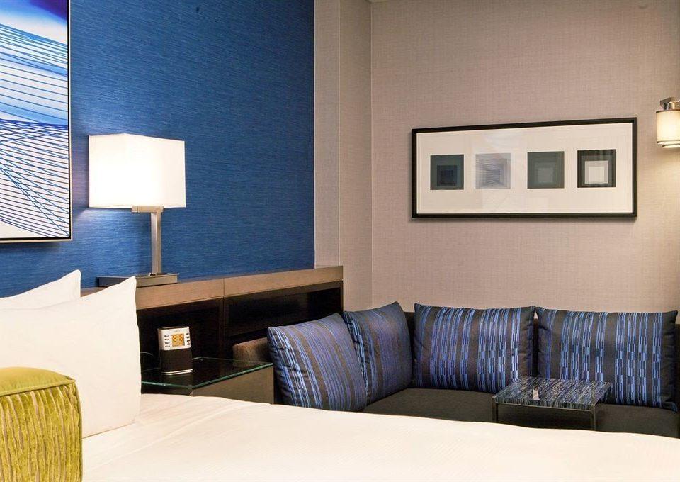 sofa property Suite condominium pillow living room home Bedroom seat lamp