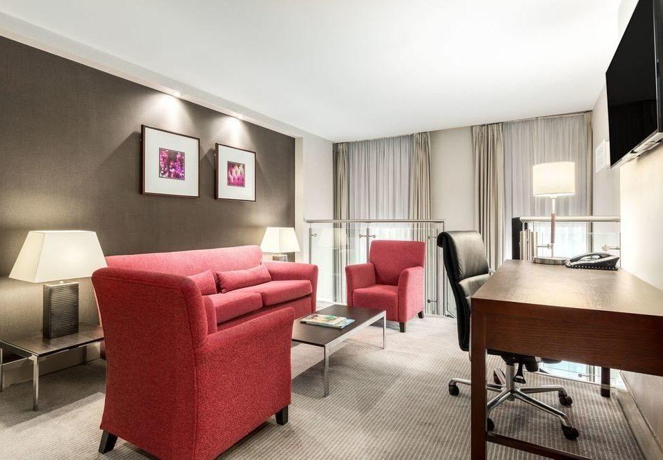 sofa property red Suite living room waiting room condominium Bedroom