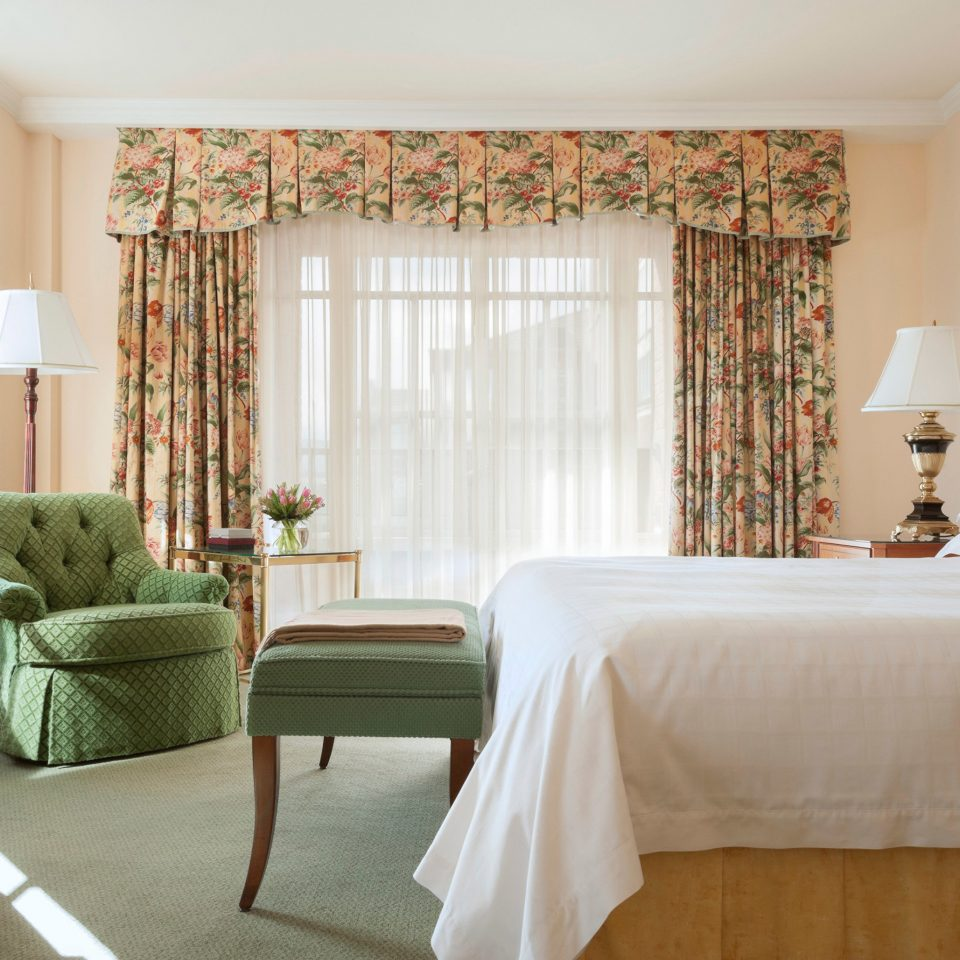 property Bedroom Suite living room home cottage curtain window treatment containing