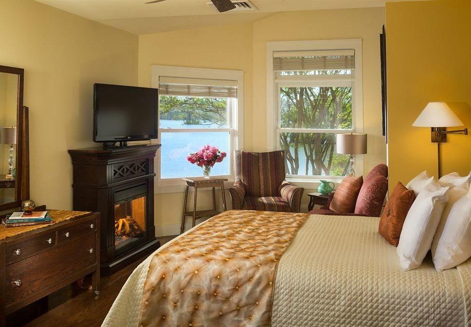 sofa property Bedroom cottage home Suite living room hardwood flat