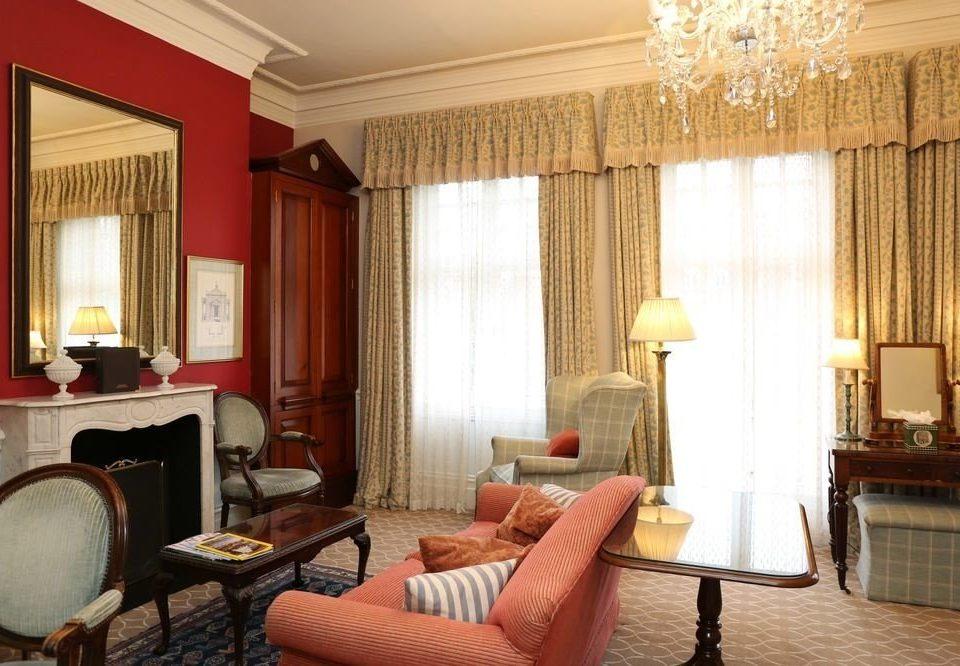 sofa property Suite living room home cottage rug flat Bedroom