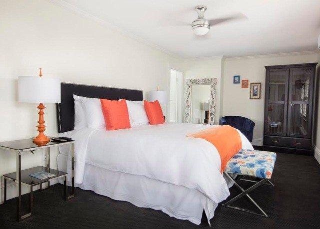 sofa property Bedroom cottage scene Suite living room orange lamp