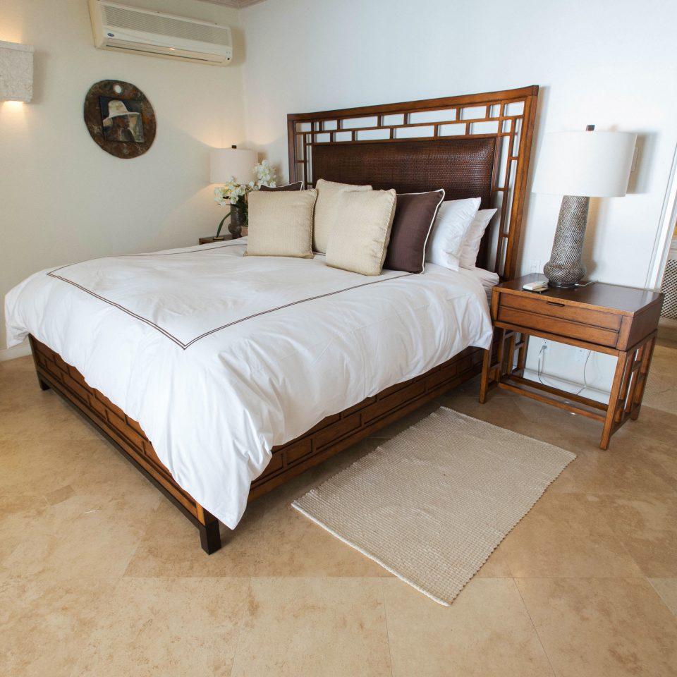 Bedroom property cottage Suite hardwood flooring Villa bed frame wood flooring tan