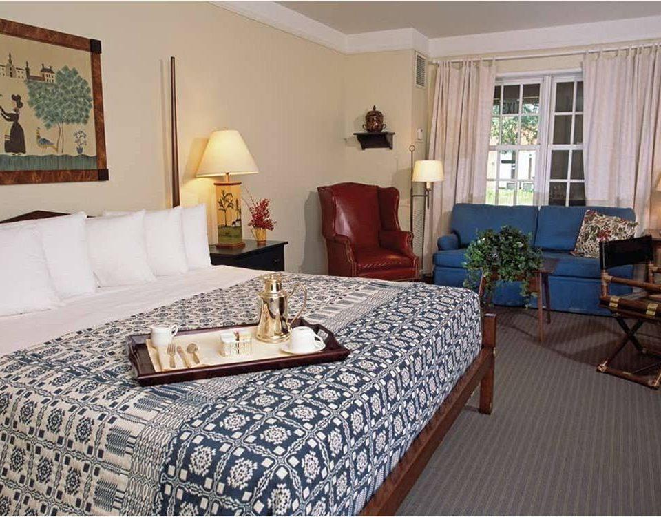 Bedroom property living room Suite cottage hardwood home pillow bed sheet Villa