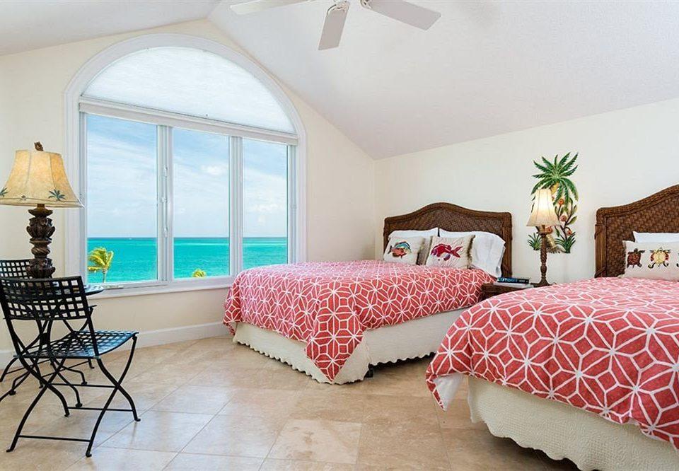 property Bedroom red cottage Suite home bed sheet living room pillow Villa