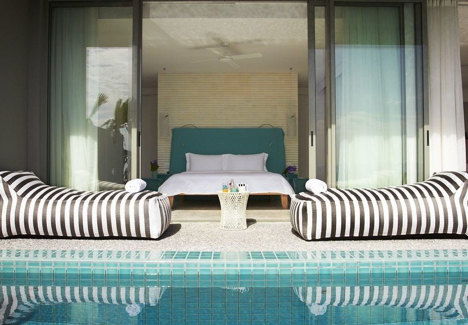 sofa property swimming pool condominium green striped bed sheet living room Suite Bedroom pillow Villa