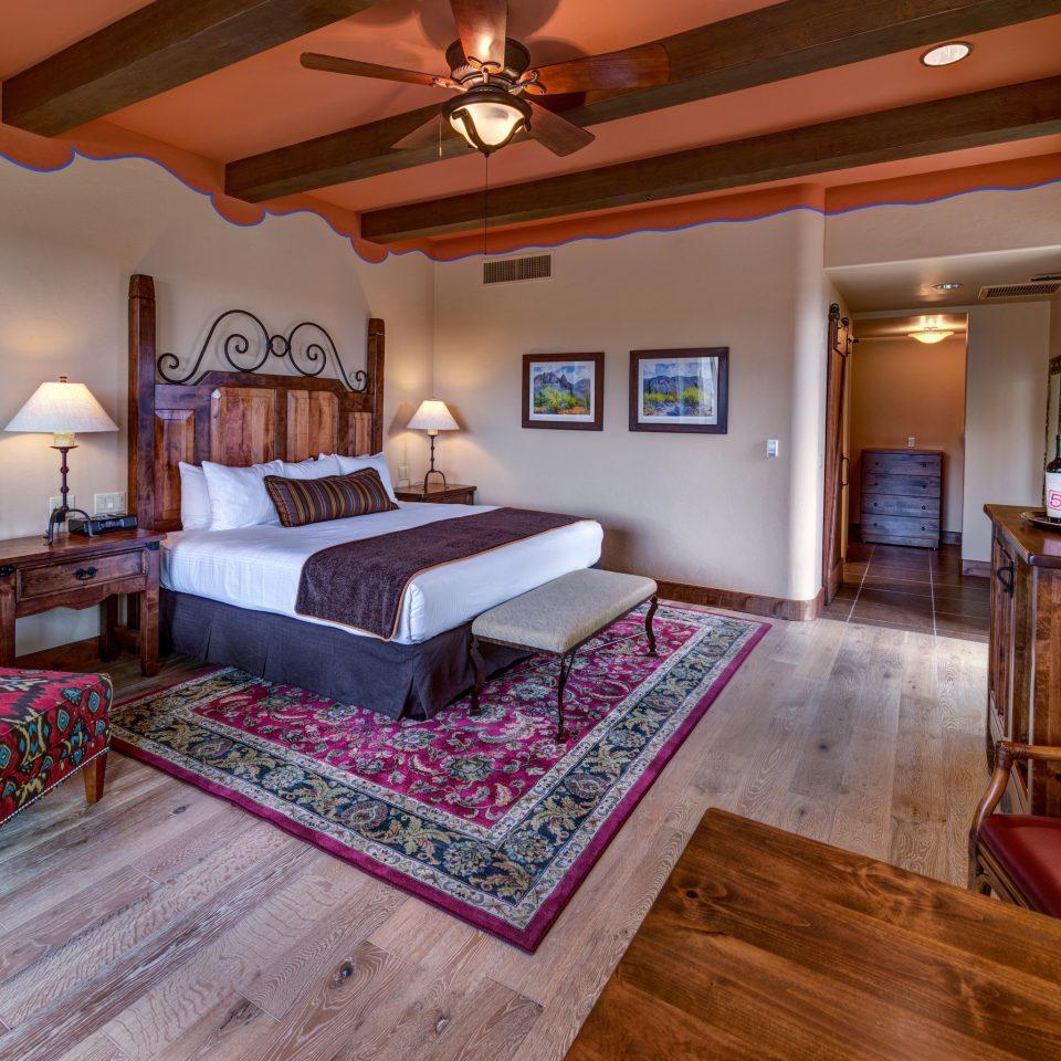 property Bedroom living room home hardwood Suite cottage Villa mansion bed sheet wood flooring farmhouse