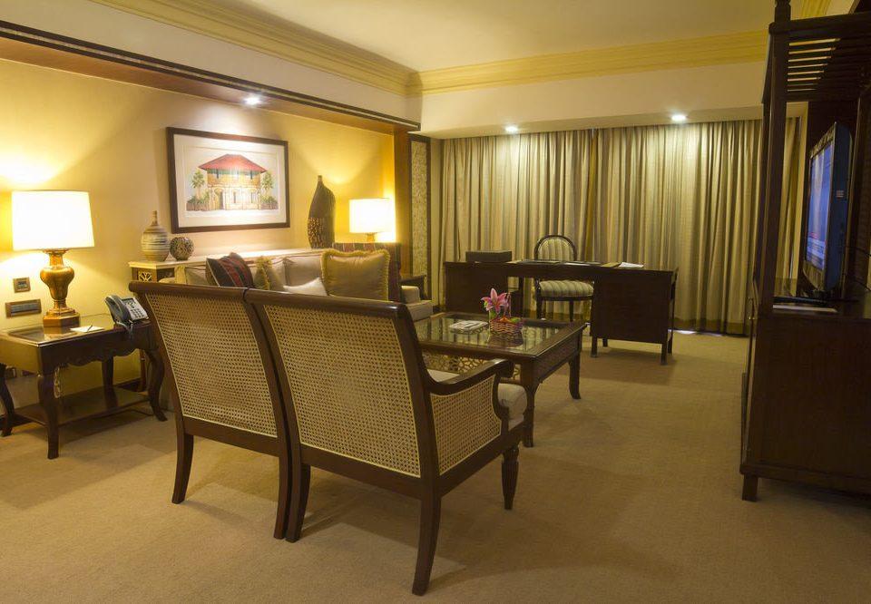 chair property Suite condominium living room Villa cottage recreation room Bedroom