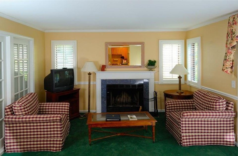 sofa property living room chair home cottage hardwood Villa Suite Bedroom