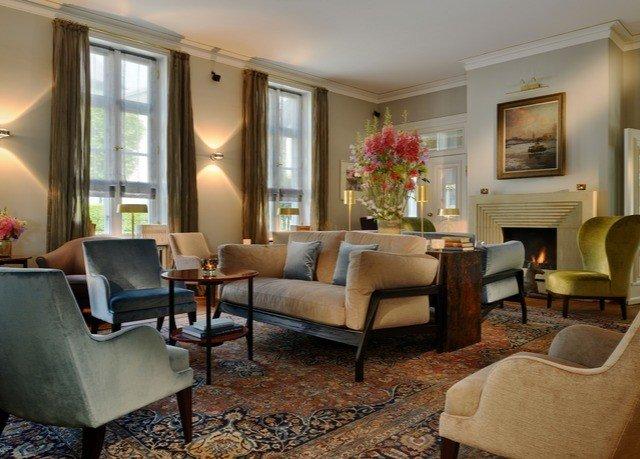 chair living room property home condominium Suite hardwood nice Villa cottage rug Bedroom
