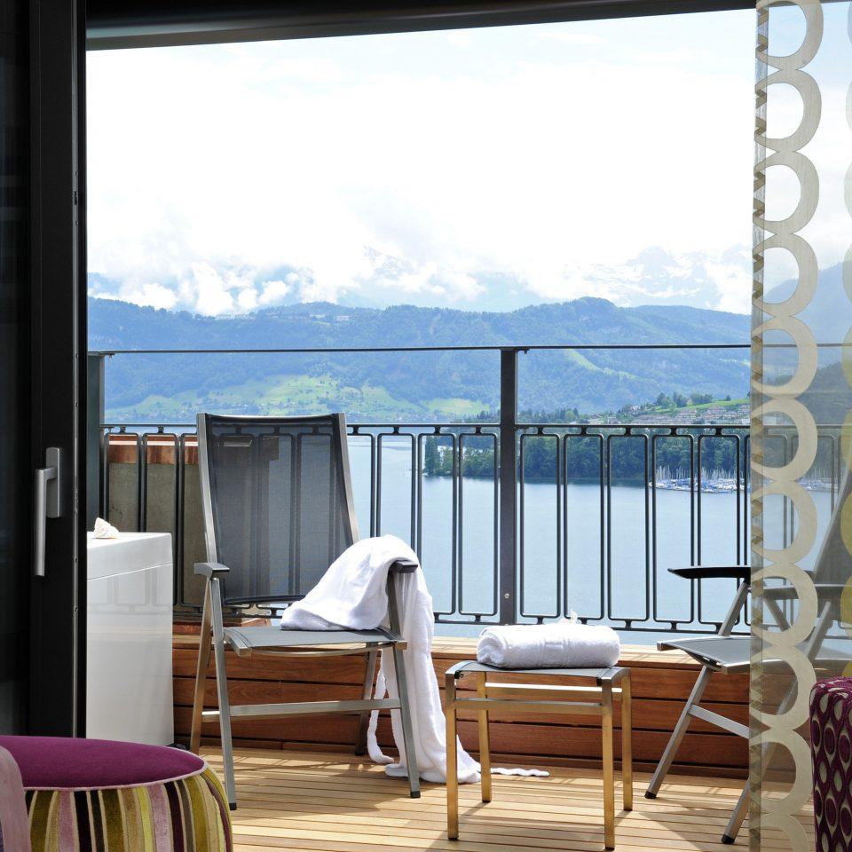 property chair overlooking living room condominium curtain window treatment Bedroom cottage Suite Villa porch