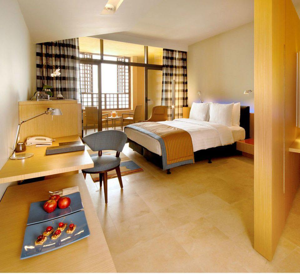 property Suite yellow hardwood living room home cottage Bedroom condominium Villa