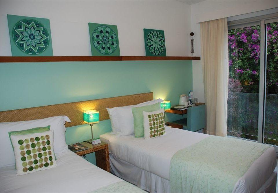 sofa green property Bedroom house living room cottage home condominium pillow Villa Suite