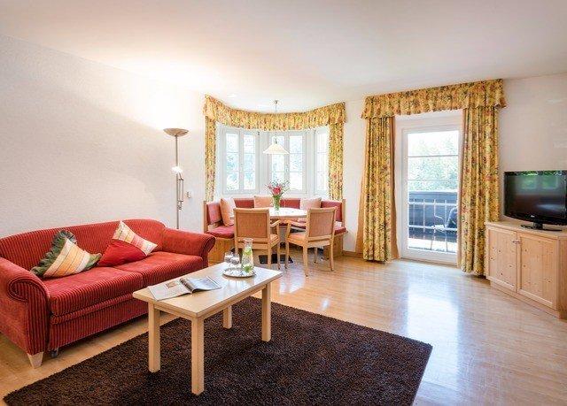 sofa property living room hardwood Villa home cottage Suite Bedroom wood flooring farmhouse condominium