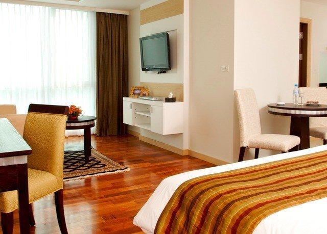 property Suite hardwood condominium living room cottage home wood flooring Villa flooring Bedroom