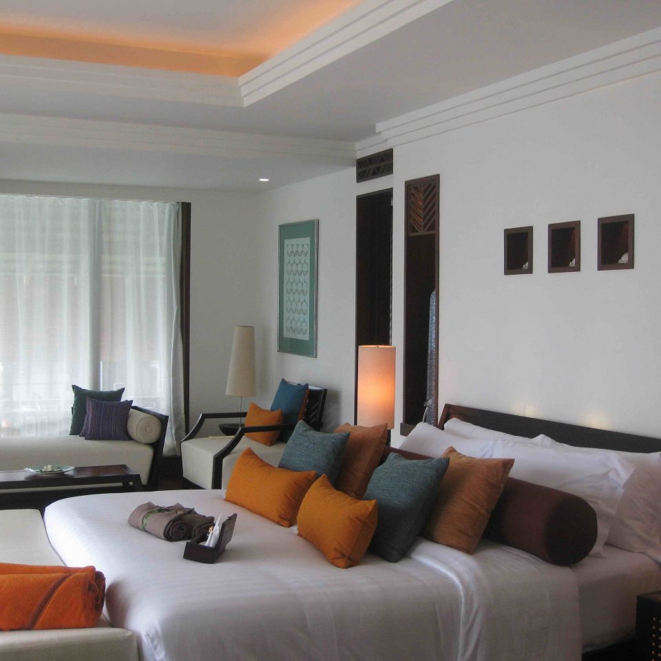 sofa property living room condominium Suite Villa home cottage flat nice orange Bedroom