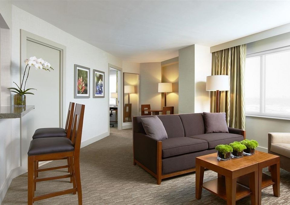 property living room home condominium Suite hardwood Villa cottage Bedroom dining table