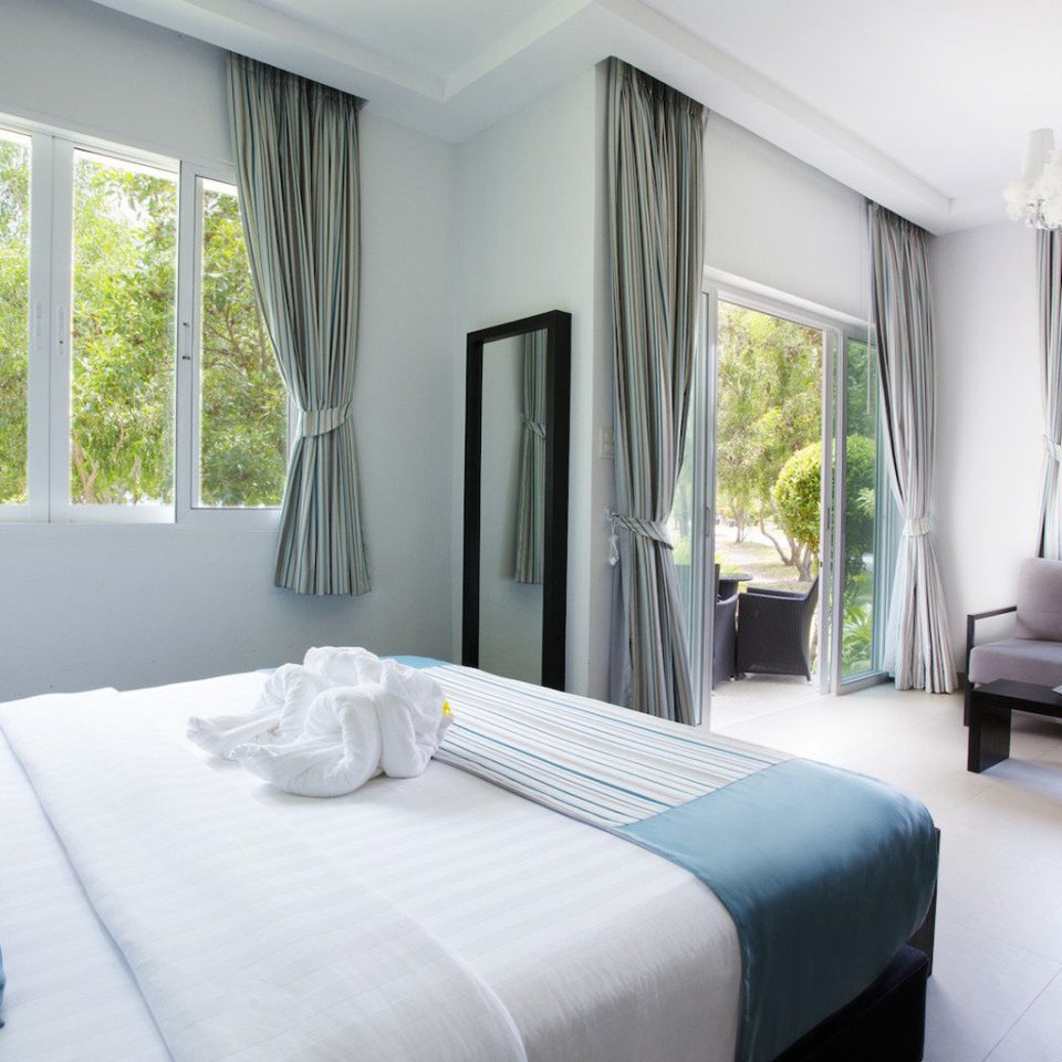 sofa property Bedroom home cottage living room Suite Villa condominium
