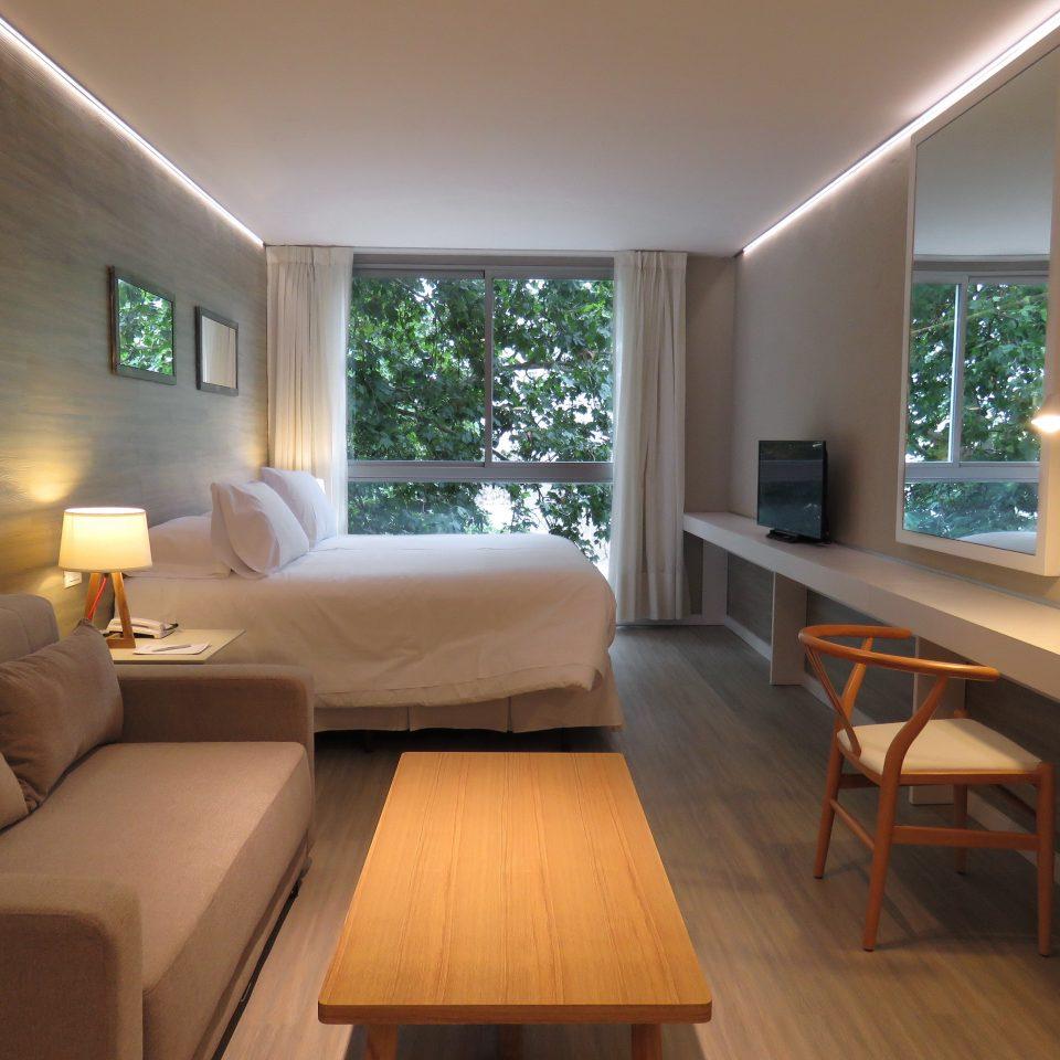 Bedroom Suite sofa property living room home hardwood condominium cottage Villa