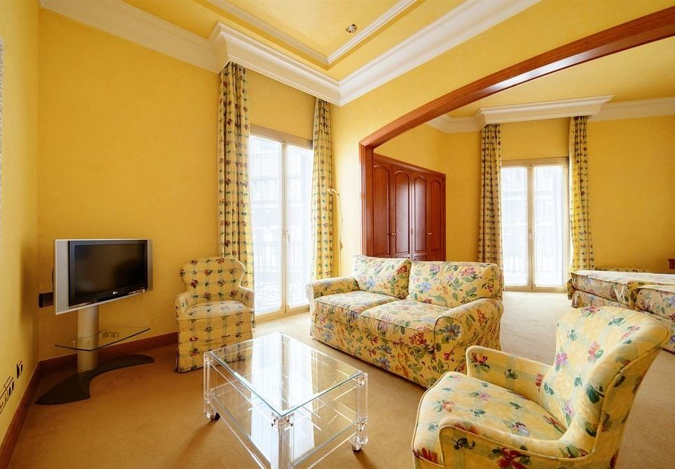 yellow property living room Suite condominium cottage Villa home Bedroom