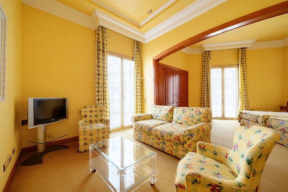yellow property living room Suite condominium cottage Villa home Bedroom