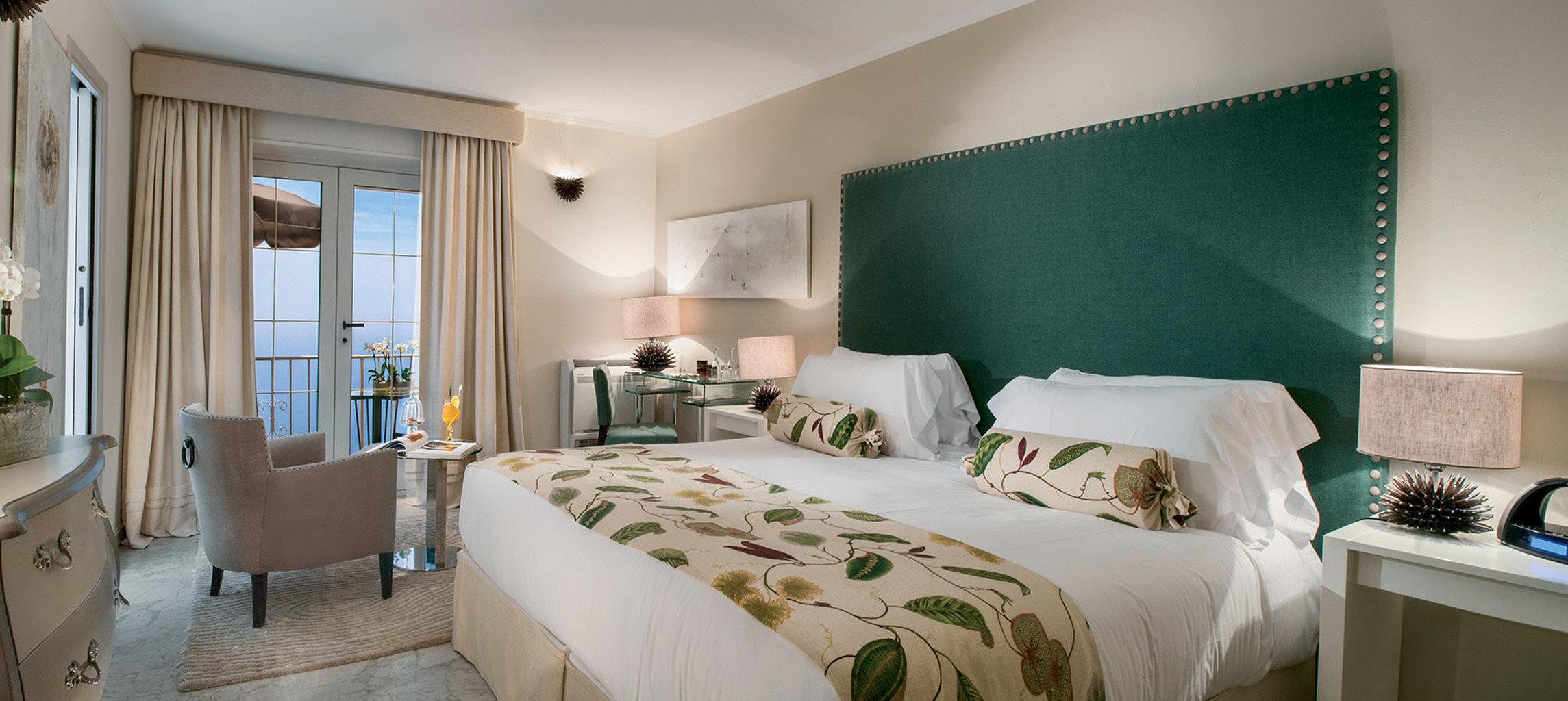 sofa Bedroom property Suite green condominium home cottage pillow living room Villa