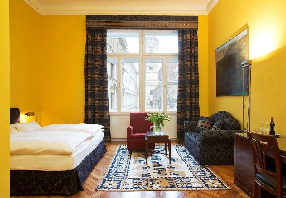 property living room condominium Suite yellow hardwood home cottage Villa Bedroom