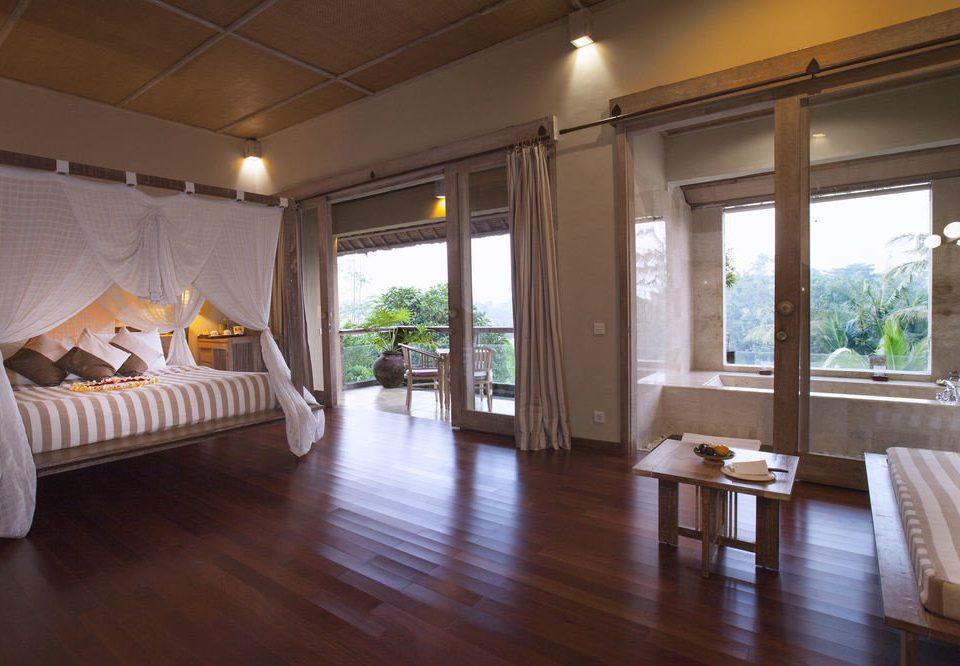 property living room hardwood home wooden wood flooring cottage Villa condominium Suite hard Bedroom