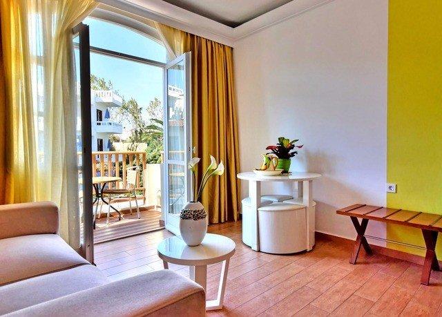 property Suite yellow living room home condominium Villa cottage Bedroom