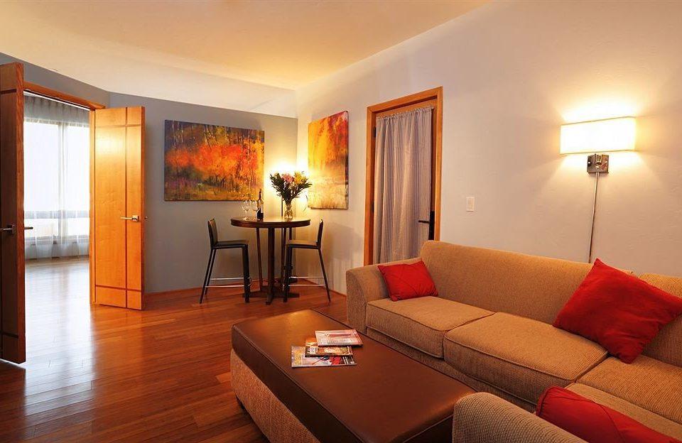 sofa property Suite living room hardwood cottage Villa orange flat Bedroom