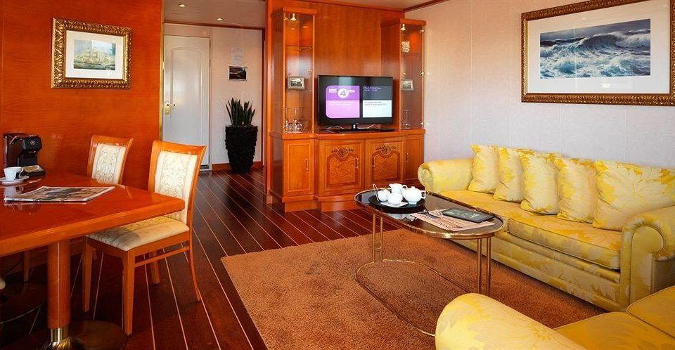 property Suite living room cottage Villa recreation room vehicle orange flat Bedroom