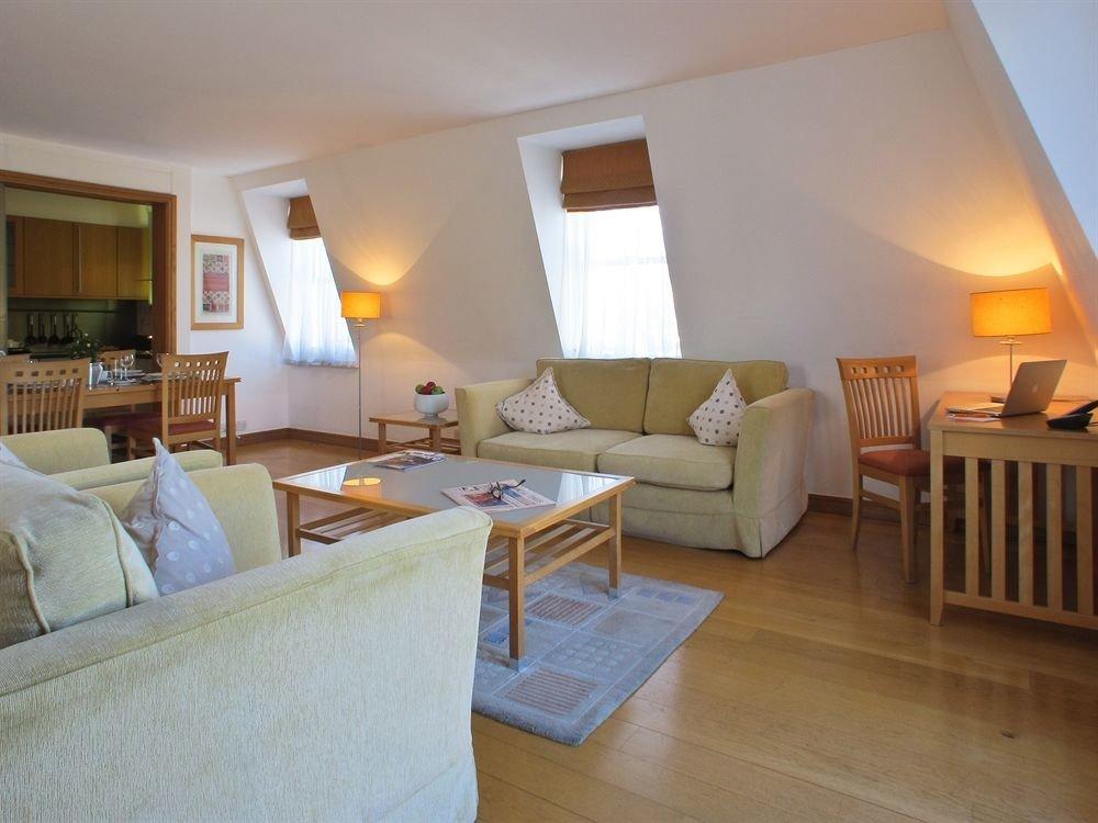 sofa property cottage Suite Villa hardwood home living room Bedroom